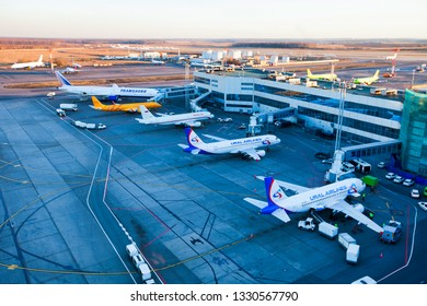 Moscow / Russia - 02.26.2014. Domodedovo International Airport. Top view of the apron of Domodedovo airport. Planes of Ural Airlines, Rossiya Airlines, Saratov Airlines, Transaero Airlines. Handling.