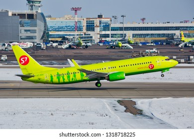 Moscow / Russia - 02.26.2018. Domodedovo International Airport.  Passenger plane Boeing 737 of S7 Airlines (Sibir Airlines) takes off from airport runway. Tanks with aviation fuel in the background.