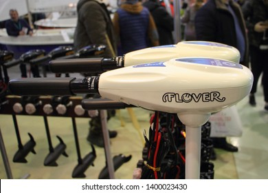 Moscow / Russia – 03 02 2019: New white transom trolling electric outboard motor Flover on exhibition Hunting and fishing - 2019 at VDNH (VVC, ENEA)