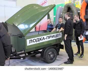Moscow / Russia – 03 02 2019: New green folding boat-trailer Koira on exhibition Hunting and fishing - 2019 at VDNH (VVC, ENEA)