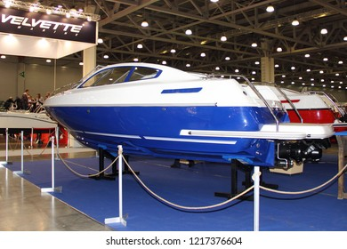 Moscow / Russia – 03 08 2018: Plastic motor boat Sirius with transverse redan at the Yacht exhibition Moscow Boat show MBS 2018 in Crocus Expo