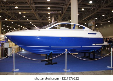 Moscow / Russia – 03 08 2018: Fiberglass motor boat Sirius with transverse redan at the Yacht exhibition Moscow Boat show MBS 2018 in Crocus Expo