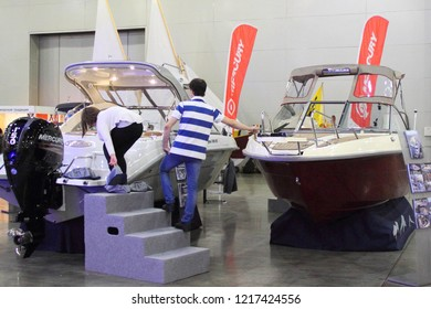 Moscow / Russia – 03 08 2018: Russian motor boats Enigma 590 Cabrio and Enigma 590 HT with awning at the Yacht exhibition Moscow Boat show MBS 2018 in Crocus Expo