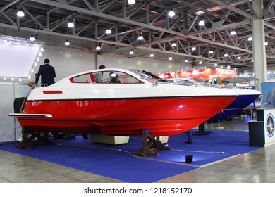Moscow / Russia – 03 08 2018: Sirius red white fiberglass motor boat with sponsons at the Yacht exhibition Moscow Boat show MBS 2018 in Crocus Expo