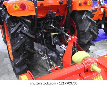 Moscow / Russia – 03 08 2018: drive for mounted units - PTO shaft and transfer case on new orange mini tractor Kioti NX 4520 NST at Russian motor boat and Yacht exhibition Moscow Boat show MBS 2018