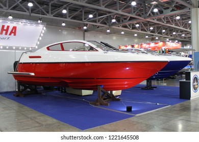 Moscow / Russia – 03 08 2018: Sirius red white plastic motor boat with sponsons at the Yacht exhibition Moscow Boat show MBS 2018 in Crocus Expo
