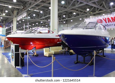 Moscow / Russia – 03 08 2018: Sirius red white and blue fiberglass motor boat with sponsons at the Yacht exhibition Moscow Boat show MBS 2018 in Crocus Expo