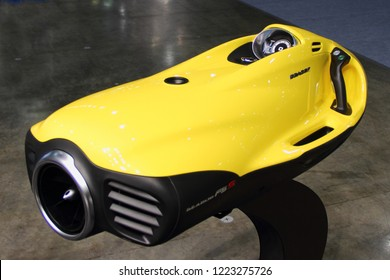 Moscow / Russia – 03 08 2018: Yellow Jet ride diving device SeaBob on Exhibition stand of Russian dealer Luxury Technology at motor boat and Yacht exhibition Moscow Boat show MBS 2018 in Crocus Expo