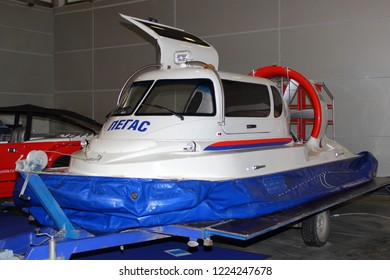 Moscow / Russia – 03 08 2018: Individual compact white hovercraft Pegas with blue skirt on Russian motor boat and Yacht exhibition Moscow Boat show MBS 2018 in Crocus Expo