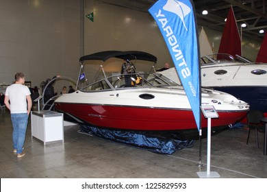 Moscow / Russia – 03 08 2018: Motor boat Stingray 205 with bimini top awning at the Russian Yacht exhibition Moscow Boat show MBS 2018 in Crocus Expo