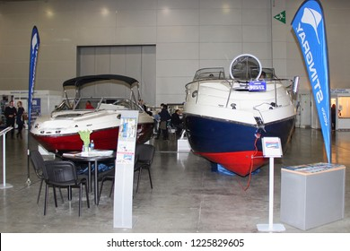Moscow / Russia – 03 08 2018: Motor boats Stingray 205 with bimini top awning and Stingray 265 CS of colors of the Russian flag at the Yacht exhibition Moscow Boat show MBS 2018 in Crocus Expo