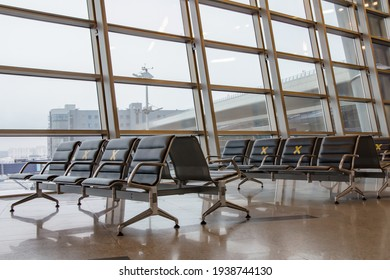 Moscow, Russia: 03.15.2021 - Vnukovo International Airport, departure area. Labeled waiting chairs for social distancing during a pandemic.