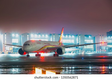 Moscow / Russia - 03.19.2019. Sheremetyevo International Airport. Passenger aircraft Boeing 787 Dreamliner of the Hainan Airlines taxiing on the airport runway. Night time.