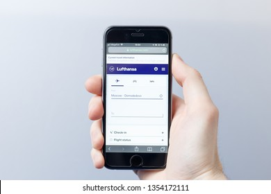 Moscow / Russia - 03.28.2019: A hand holding a smartphone which displays LUFTHANSA logo on the official website homepage. LUFTHANSA logo visible on smartphone screen. Illustrative editorial