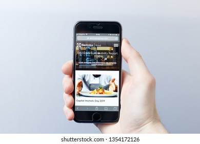 Moscow / Russia - 03.28.2019: A hand holding a smartphone which displays ELECTROLUX logo on the official website homepage. ELECTROLUX logo visible on smartphone screen. Illustrative editorial