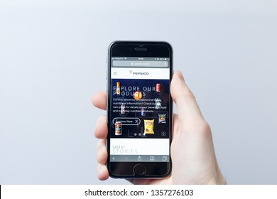 Moscow / Russia - 04.02.2019: A hand holding a smartphone which displays PepsiCo logo on the official website homepage. PepsiCo logo visible on smartphone screen. Illustrative editorial