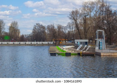 Moscow, Russia, 04.20.2018. Boat station on a pond on a sunny spring day. Boats and catamarans for hire