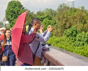 Moscow, Russia, 05.18.2018. Tourists from Asia, in the foreground, take a selfie on the observation deck of the Vorobyovy gory