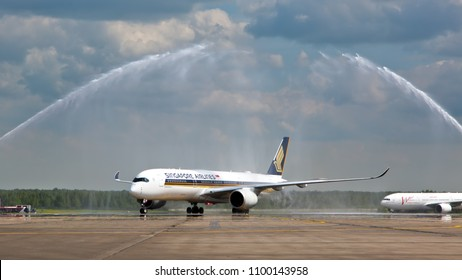 Moscow / Russia - 05.30.2017. Domodedovo International Airport.  The water cannon welcomes the Airbus A350 of Singapore Airlines.