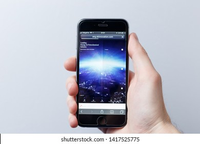 Moscow / Russia - 05.31.2019: A hand holding a smartphone which displays SK Innovation logo on the official website homepage. SK Innovation logo visible on smartphone screen. Illustrative editorial