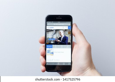 Moscow / Russia - 05.31.2019: A hand holding a smartphone which displays Asahi Kasei logo on the official website homepage. Asahi Kasei logo visible on smartphone screen. Illustrative editorial
