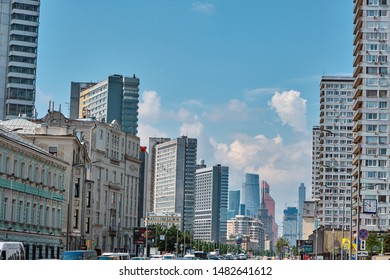 Moscow \ Russia 06 10 2019: Novy Arbat Street traffic. View of New Arbat, cloudy sky and Moscow city
