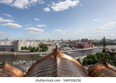 Moscow, Russia - 06/03/2019: The view to the roofs of the city and a famous monument to Peter the Great in the center, view from the Christ the Savior Cathedral.
