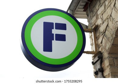 """Moscow / Russia - 06/12/2020: a sign with the logo of the """"Fix Price"""" chain of stores on the facade of the building in the form of a round light box."""