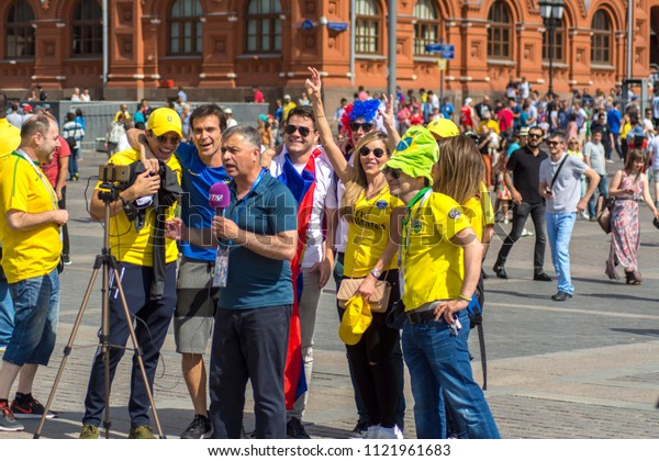 Moscow, Russia, 06.27.2018 Correspondent makes a record with fans from Brazil before the football match Serbia-Brazil, Red square.