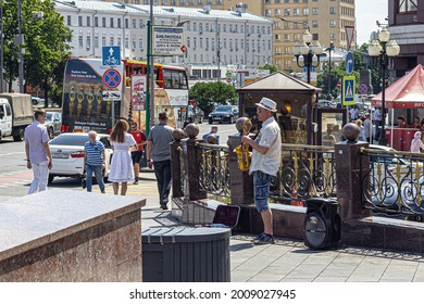 Moscow, Russia, 06.28.2018. Saxophonist plays a saxophone on a small patch on the Arbat. The musician earns a living