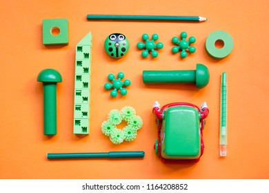 Moscow, Russia- 08 13 2018: green children's toys, laid out in a pattern on a orange background, top view - Shutterstock ID 1164208852