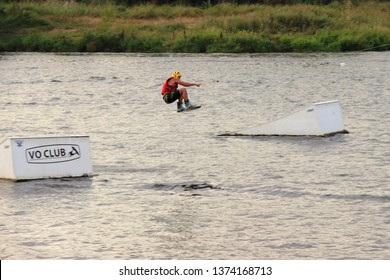 Moscow / Russia – 08 22 2017: Wakeboarder jump on the wake board in the Wakeboard club Strogino in summer day