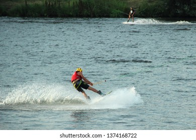 Moscow / Russia – 08 22 2017: Wakeboarder rides on the wake board in the Wakeboard club Strogino in summer day