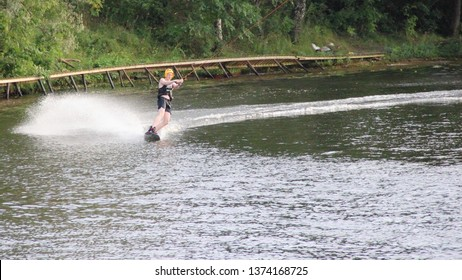 Moscow / Russia – 08 22 2017: Wakeboarder rides in turn on the wake board in the Wakeboard club Strogino in summer day