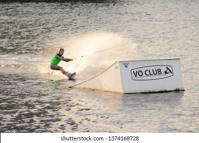 Moscow / Russia – 08 22 2017: Wakeboarder rides naer ramp on the wake board in the Wakeboard club Strogino in summer day