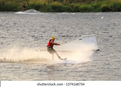 Moscow / Russia – 08 22 2017: Wakeboarder rides on the wake board on ramp background in the Wakeboard club Strogino in summer day