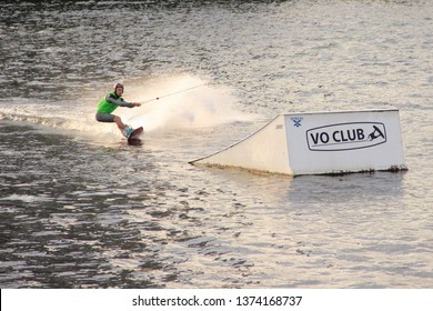 Moscow / Russia – 08 22 2017: Wakeboarder rides near springboard on the wake board in the Wakeboard club Strogino in summer day