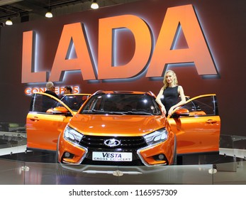 Moscow / Russia – 08 31 2016: Lada Vesta Cross Concept with show girl in exhibition Moscow International Automobile Salon MMAS 2016 in Crocus Expo, motor show