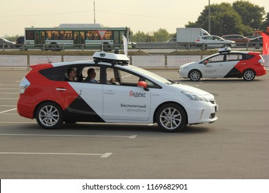 Moscow / Russia – 08 31 2018: Two self drive cars Yandex Taxi on outdoor territory of automotive exhibition Moscow International Automobile Salon MMAS 2018 MIAS in Crocus Expo, motor show