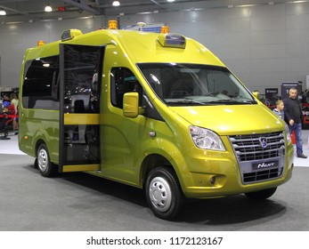 Moscow / Russia – 08 31 2018: Front side view of russian yellow commercial mini bus taxi GAZ GAZelle Next on exhibition Moscow International Automobile Salon MMAS 2018 MIAS in Crocus Expo motor show