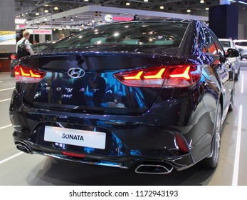Moscow / Russia – 08 31 2018: Rear view of black sedan car new Hyundai Sonata on exhibition Moscow International Automobile Salon MMAS 2018 MIAS in Crocus Expo motor show