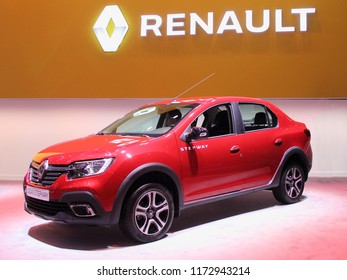 Moscow / Russia – 08 31 2018: Side-front view of red French car Renault Logan Stepway on exhibition Moscow International Automobile Salon MMAS 2018 MIAS in Crocus Expo motor show