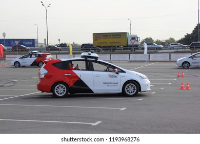 Moscow / Russia – 08 31 2018: Self drive cars Yandex Taxi driving no drivers on open territory of automotive exhibition Moscow International Automobile Salon MMAS 2018 MIAS in Crocus Expo, motor show