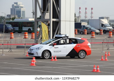 Moscow / Russia – 08 31 2018: Self drive car Yandex Taxi driving no driver on open territory of automotive exhibition Moscow International Automobile Salon MMAS 2018 MIAS in Crocus Expo, motor show