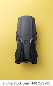 Moscow / Russia - 08.06.2019: New drone DJI Mavic 2 PRO with HASSELBLAD camera on yellow background. DJI logo visible on the body. High-tech aircraft. Illustrative editorial. Top view. Flat lay