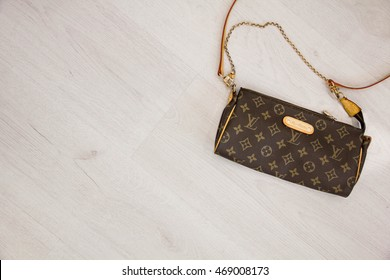 Moscow, Russia - 08.14.2016 fake handbag Louis Vuitton, Editorial place for text. Top view, flat lay with copyspace for slogan or text message.