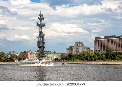 Moscow, Russia, 08.18.2021. Urban landscape with a monument to Peter I and passing tourist ships in the Yakimanka district on the Moscow River