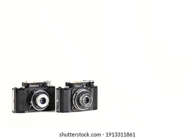 MOSCOW, RUSSIA, 09 FEBRUARY, 2021. The old Soviet 35mm. scaling film cameras Smena 3 and Smena 2, released 1959 and 1960 on white background.
