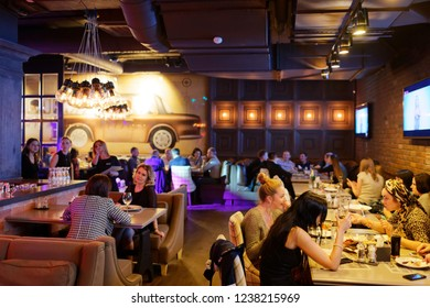 Moscow, Russia, 09.06.2018: Group of people in the pub having fun. Young friends enjoying a night in club.