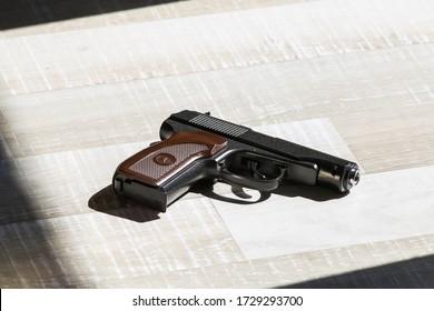 Moscow. Russia. 1 may 2020 - Makarov pistol on crime scene, scene of crime, murder scene. Gun on the floor.